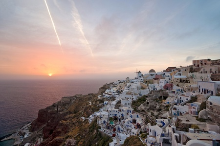 sunbeds: Santorini sunset in Ia village  Stock Photo