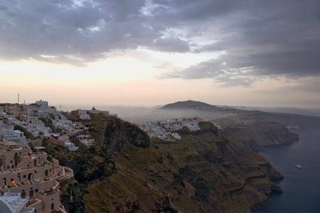 Early morning fog above Santorini villages and sunrise photo