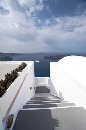 Caldera view in Santorini island with Stairway to the buildings on the cliff photo
