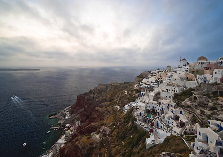 Santorini cloudy eveningin in Ia village  photo
