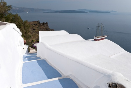 eruptive: Caldera view in Santorini island with blue steps to the buildings on the cliff Stock Photo
