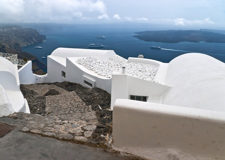eruptive: Caldera view in Santorini island with white buildings and ships