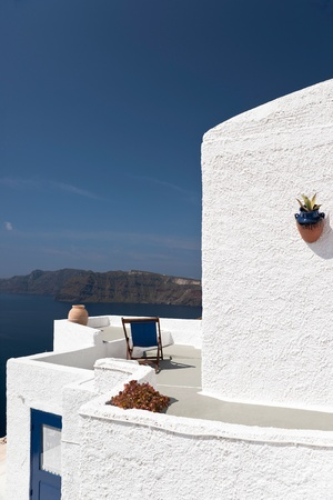 Whitewashed building with decoration and the island Stock Photo