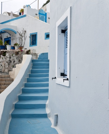 White buildings and blue staircase in Imerovigli village photo