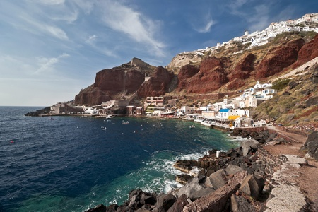 ia: Ia houses view with volcanic rock of red and black colors and the port below Stock Photo