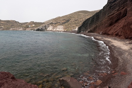 Santorini Red beach with incoming waves photo