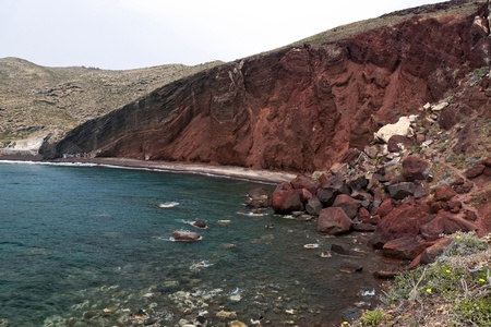 Red beach with rockfall in Santorini  Stock Photo - 13079946