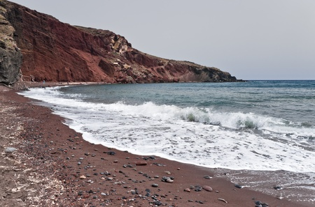 incoming: Famous Santorini Red beach with incoming waves