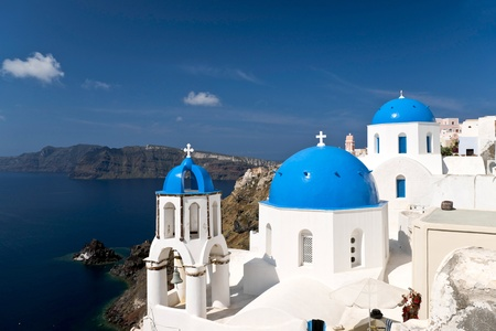 Famous Santorini churches with blue cupolas Stock Photo
