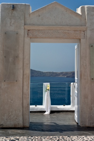 steep cliffs sign: Wedding white veiling with yellow flowers on the transparent fence Stock Photo