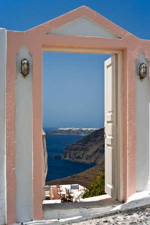 ia: Open door of Thira taverna with Ia view
