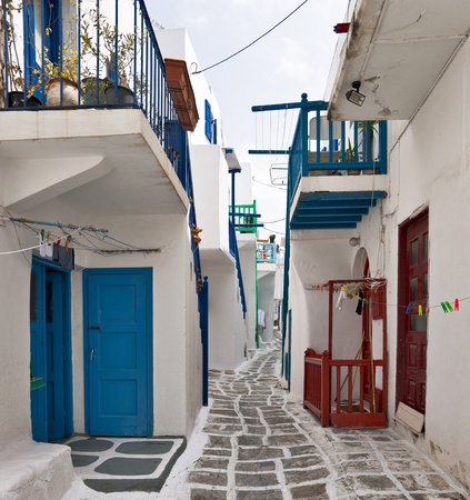 Mykonos street with external colorful stairs of the houses  photo