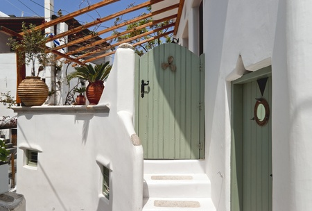 whitewashed: Entrance to whitewashed house with green door