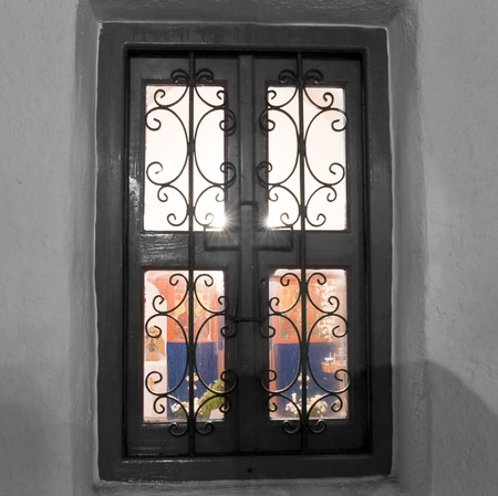 grating: Church window with grating and view of icons inside Stock Photo