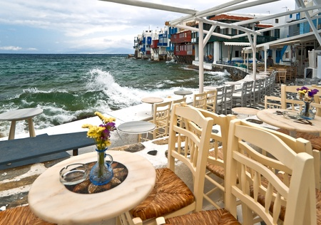 Cafe of Mykonos Small Venice in cold spring day photo