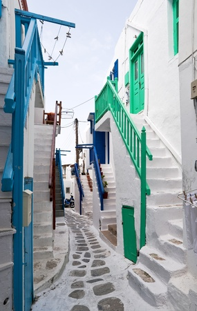 Mykonos street with external colourful stairs of the houses  photo