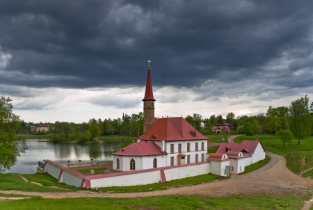 Earthen Prioratsky palace with red roof in Gatchina, Russia