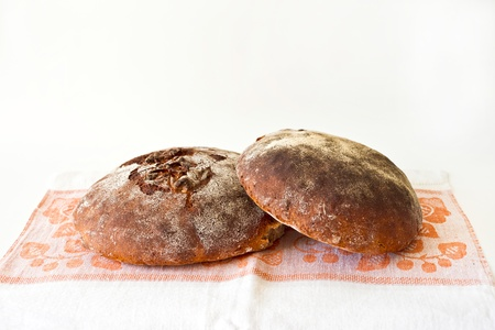 dishcloth: Two loaves of rye sourdough bread on the dish-cloth