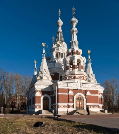 white russian: Renovated Red and white russian brick church in early spring sunny day
