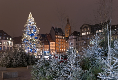 Christmas tree with decoration in the city square among houses photo