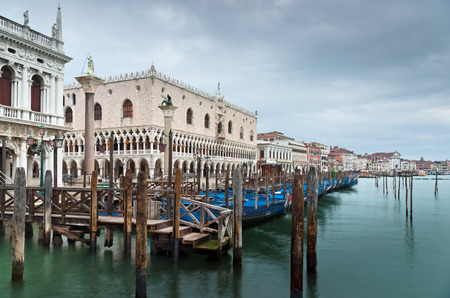 theodor: S Marco Canal view with gondolas, Doges Palace, Biblioteca Marciana, S Theodor and S Marco columns in winter