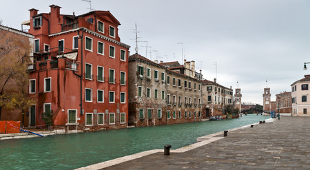 arsenal: Venice Arsenal entrance with towers and canal view in winter time Stock Photo
