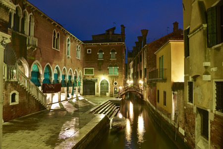 venecian: Venecian canal with bridge and houses at night in winter