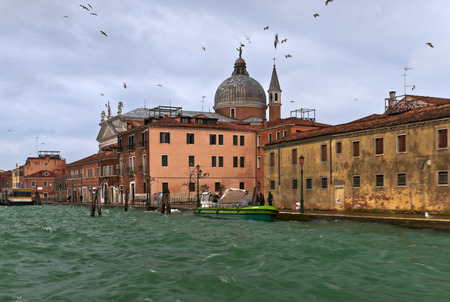 Guidecca houses and Santissimo Redentore Church next to the water photo