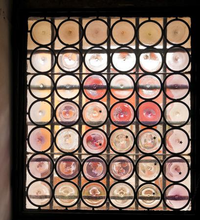 bottoms: Venetian window glass of a house like bottle bottoms