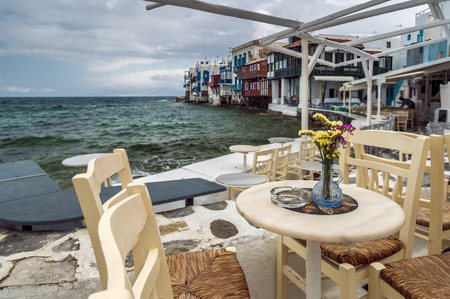 Cafe of Mykonos Little Venice in cold spring day photo