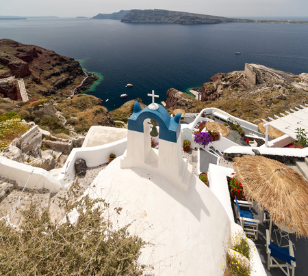 eruptive: Santorini view with church, bell-tower and volcanic rock