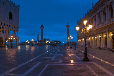 piazza san marco: Piazza San Marco at night in winter with Palazzo Ducale, S.Theodor and S.Marco columns and Giorgio Maggiore church view
