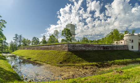 rampart: White tower with rampart and graff in spring, Aleksandrjvsky park, Pushkin, Russia Stock Photo