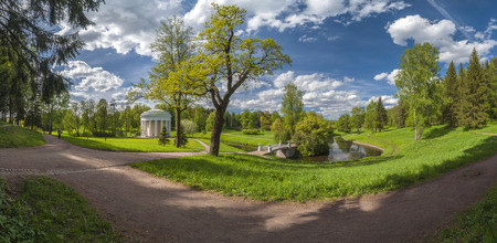 water grass: Park panorama with classical building and bridge under beautiful cloudy sky in spring