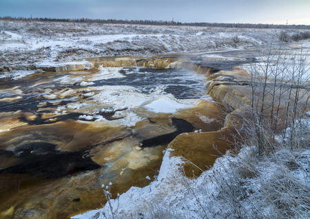 Waterfall of Tosna river in cold winter day