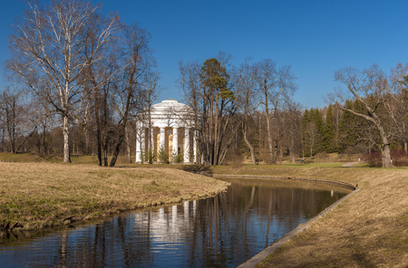 Classical rotunda view with river in beautiful early spring park, Pavlovsk, Russia
