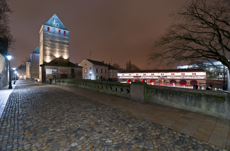 Towers of Ponts Couverts and Terrasse Panoramique bridge with illumination at night, Strasbourg, France Stock Photo