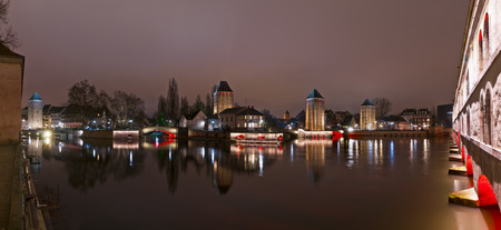 Towers and bridges panorama with illumination at night, Ponts Couverts and Terrasse Panoramique, Strasbourg, France