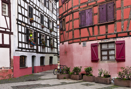 Timber framing buildings with shutters and jalousie in Strasbourg street
