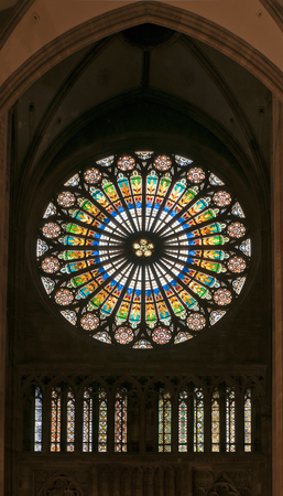 Stained glass window of Strasbourg cathedral with floral multicolored image