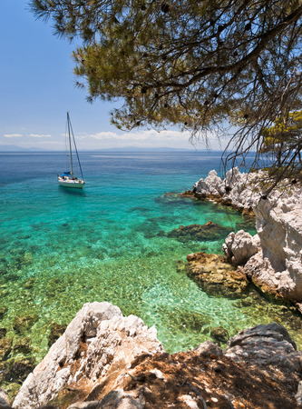 Landscape with yacht, rocks and clear Aegean Sea water, Skopelos island Stock Photo