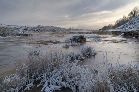 River with snow and ice over water in cold winter day