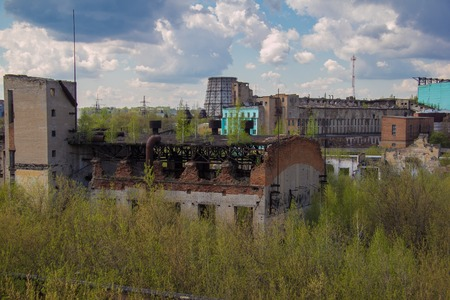 abandon: Abandoned factory of synthetic rubber overgrown by trees, ruins of buildings and cooling towers