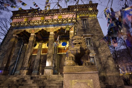 saint: Lion statue near Saint Petersburg Buddhist Temple Datsan Gunzechoyney at night Stock Photo