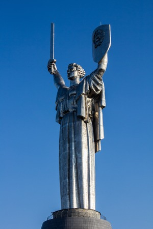 soviet flag: Kiev, Ukraine. The Motherland Monument. The sculpture is a part of the Museum of The History of Ukraine in World War II Stock Photo