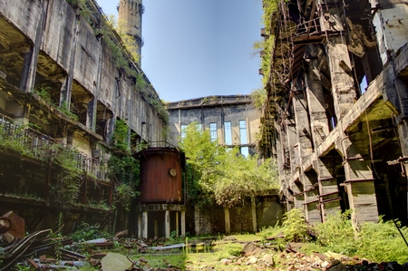 stalker: Abandoned, destroyed by war and overgrown machinery of Tkvarcheli power plant, Abkhazia, Georgia