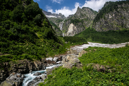 Cool mountain stream flowing from under the glacier. Highland pass in Upper Kodori District near border of Georgia - Abkhazia