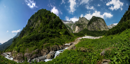 abkhazia: Nature view, cool mountain river stream flowing from under the glacier on background of mountain sierra. Highland pass in Upper Kodori District near border of Georgia - Abkhazia Stock Photo