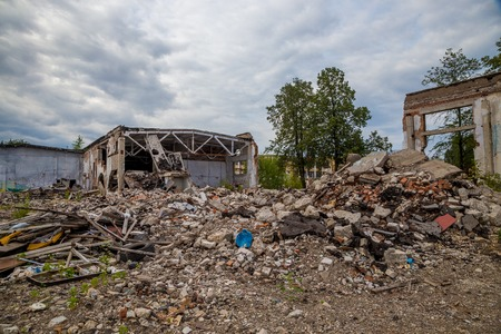 Pile of debris of a destroyed building. Pieces of Metal and Stone are Crumbling from Demolished