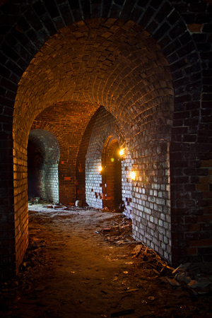 Dungeon under the old german fortress illuminated by lantern and candles Stok Fotoğraf - 69574626
